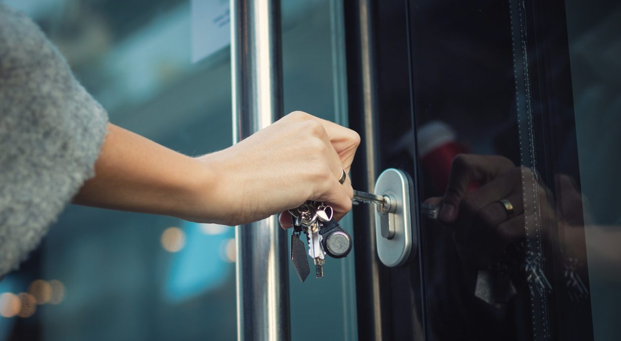 Woman using a master key system for office building