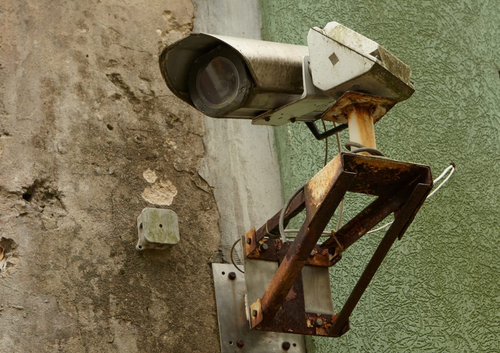 A rusty old security camera