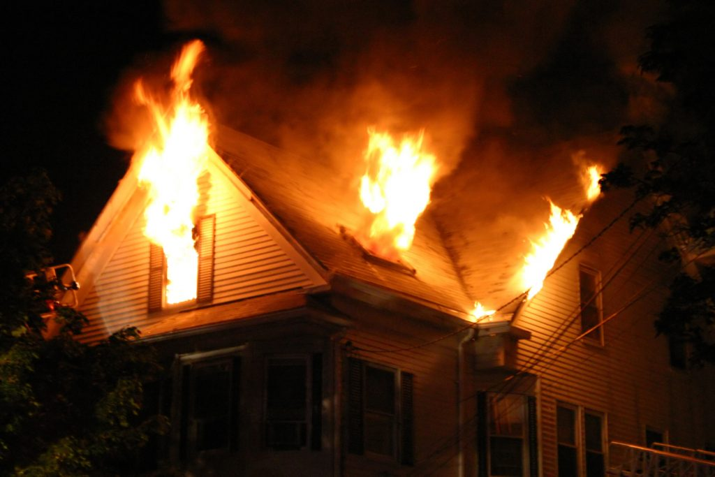 A house on fire at night