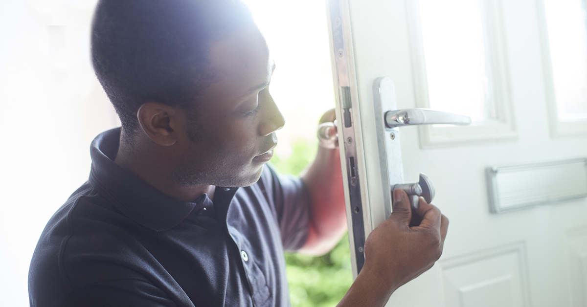 Locksmith changing lock on front door